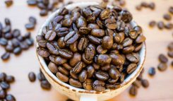 Kaffekopp med kaffebönor