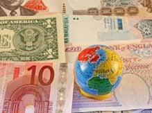 Valutor med en jordglob